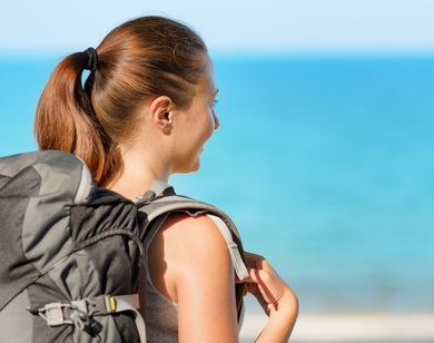 Young female backpacker on a beach