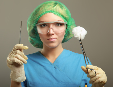 Portrait of young woman doctor surgeon (or nurse) with scalpel.