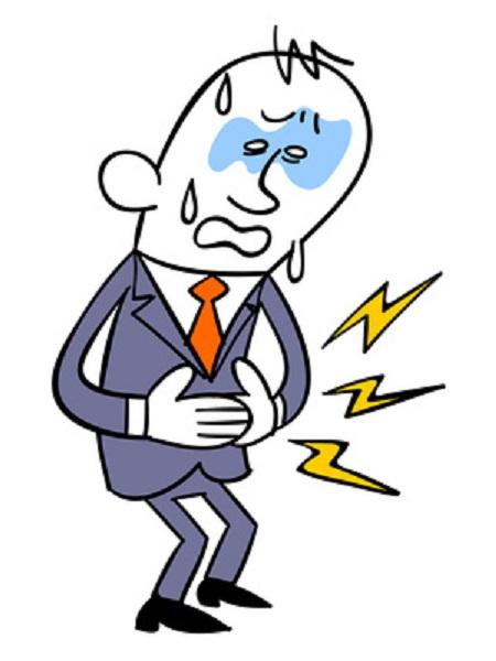 腹痛に苦しむビジネスマン