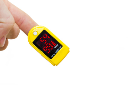 pulse oximeter on a mans finger