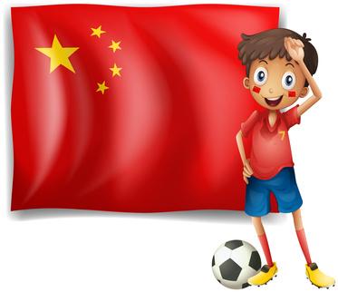 中国の国旗とサッカー少年