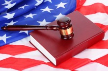 judge gavel and book on american flag background