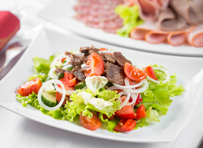 Vegetable salad with beef meat in restaurant
