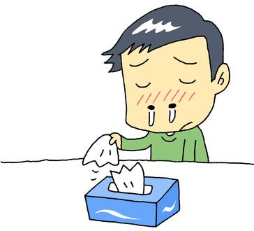 風邪をひいて鼻水をたらす男性