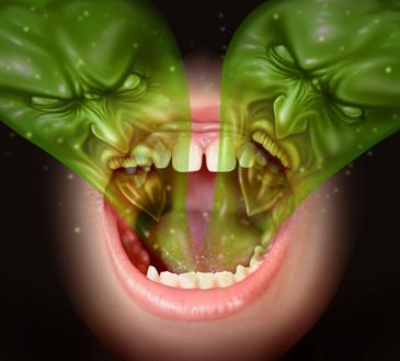 口をあけて異物が入るイメージ
