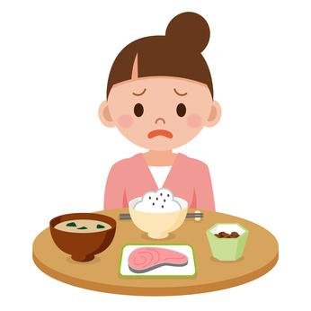 つわりで食欲不振の若い女性