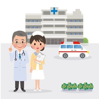 病院を背景にして立つ医師と看護師