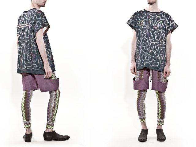 紫のハーフパンツをはく男性