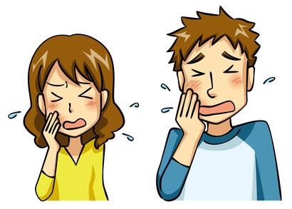 歯痛で苦しむ男女