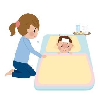 発熱した子供を看病する女性