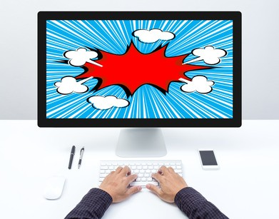 Man hand on desktop computer keyboard with comic boom screen monitor
