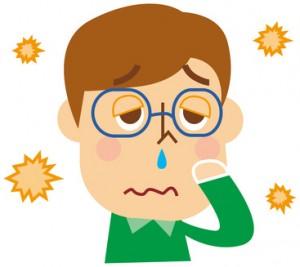 花粉症で苦しむ男性