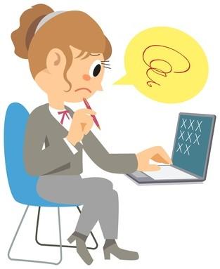 パソコンにイライラする女性
