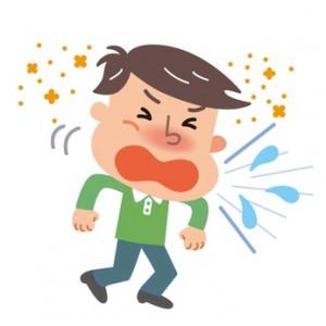 花粉症でくしゃみが止まらない男性
