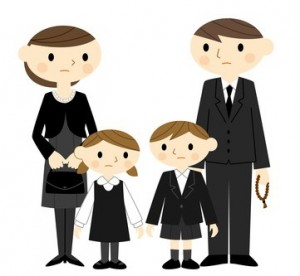 葬式に参列する家族